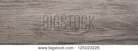 surface of the brown wooden plank untreated