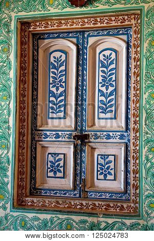 Colorfully decorated window panes and casing with floral design at Jaivilas Palace Museum, Gwalior, Madhya Pradesh, India, Asia