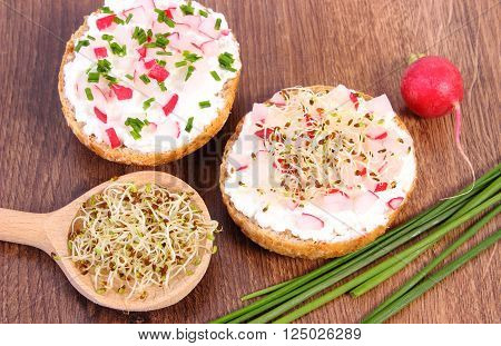Freshly prepared vegetarian sandwich with cottage cheese vegetables alfalfa and radish sprouts healthy lifestyle diet food and nutrition