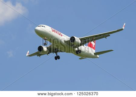ST. PETERSBURG, RUSSIA - JUNE 29, 2015: Airbus A320 (HB-JLT) Swiss International Air Lines landing in Pulkovo airport