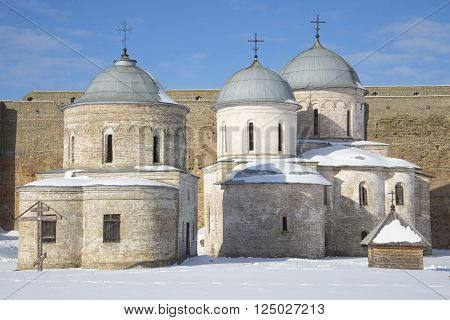 Two ancient church in the Ivangorod fortress sunny winter day. Ivangorod, Russia