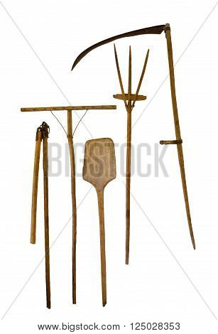 old garden tools shovel pitchfork rake scythe isolated on white background