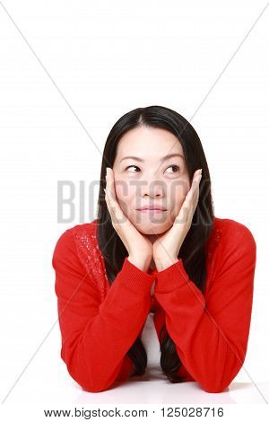 portrait of Japanese woman thinks about something