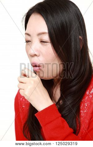 portrait of Japanese woman coughing on white background