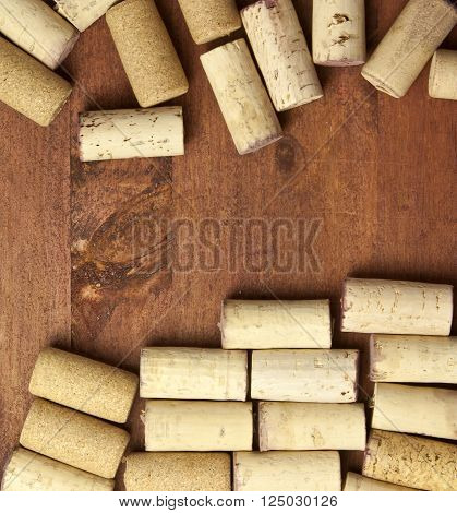 Wine corks forming a frame on a dark wooden background texture a wine card or banner design template with copyspace