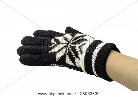 hand in a black and white woollen glove on a white background