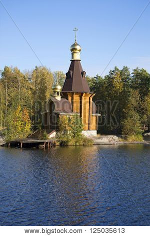 The wooden Church of the Apostle Andrew on Vuoksa gold autumn. Leningrad region, Russia
