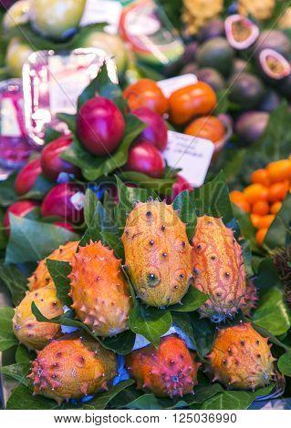 La Boqueria market with tropical fruits in Barcelona, Spain.  La Boqueria market, Europe's largest and most famous food markets.