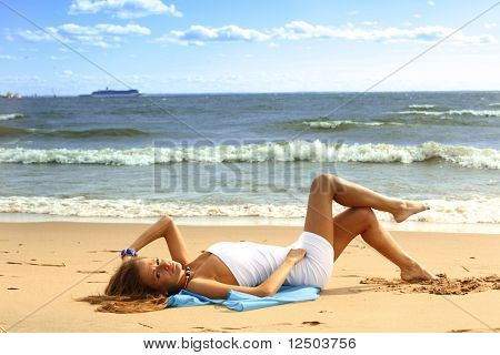 woman laying on sand