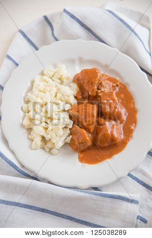Home made goulash with dumplings on a plate