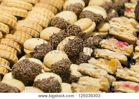 variety of decorated sweet pastry with chocolate