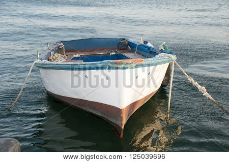 Fishing boat used for fishery moored at the port in Spain