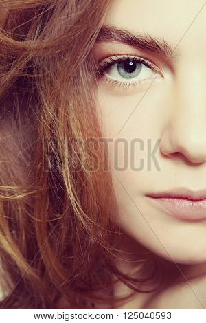 Vintage style close-up portrait of young beautiful girl with clean make-up