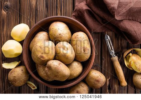 raw new potatoes in a bowl on table