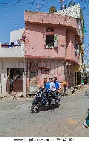 UDAIPUR INDIA - 21ST MARCH 2016: Streets scenes in Udaipur India during the day. Showing people motorbikes and buildings