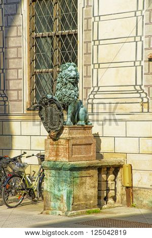 MUNICH GERMANY - MAY 8 2013: Lion statue near Munich Residence in Munich in Germany. The Munich Residenz used to be the royal palace. It is the largest palace in Germany.
