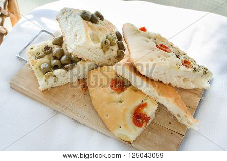 flatbread italy focaccia tomatoes olives focaccia flat oven baked Italian bread genovese ligure