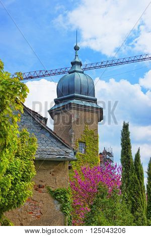 Spire of New Castle in Baden-Baden . Baden-Baden is a spa town. It is situated in Baden-Wurttemberg in Germany.