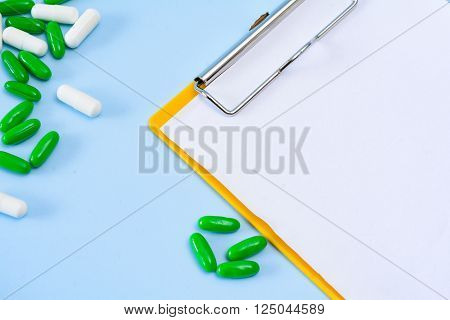Medical conceptual photo with pills and injection