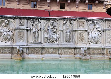 Fountain of joy - a medieval marble fountain in Siena. Panel Fonte Gaia Piazza del Campo Siena Tuscany Italy ** Note: Soft Focus at 100%, best at smaller sizes
