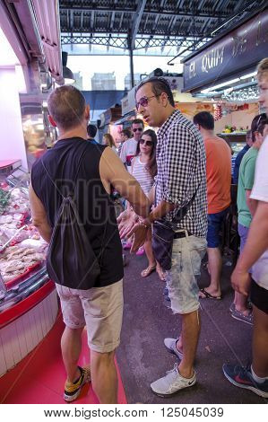 SPAIN, BARCELONA, JUNE, 29, 2015 - Guard arrested the thief and put them handcuffed on the La Boqueria Market in Barcelona, Spain.