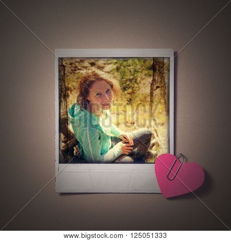 Beautiful girl instant photo and small red paper heart. Photos in grunge style.