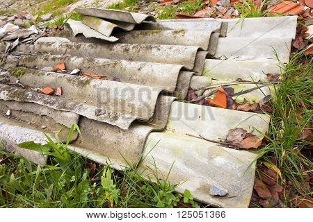 Illegal asbestos dumping - Roofing asbestos panels illegally abandoned in nature