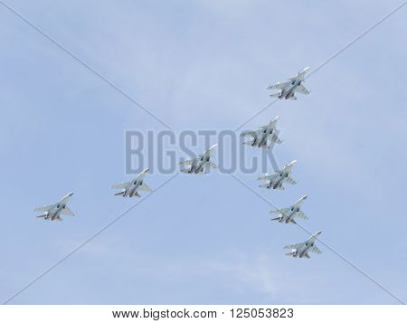 Moscow-May 9 2015: Aerobatic team Russian Falcons eight military gray-blue Su-30 is flying high in the sky at the Victory Day parade May 9 2015 Moscow Russia
