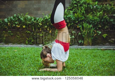 Fitness Woman On Head - Young Attractive Girl Doing The Headstand