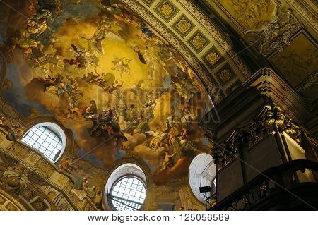 VIENNA, AUSTRIA - MARCH 12, 2016: Austrian National Library admire the luxurious ceiling in the Hofburg Palace on May 30 , 2016 in Vienna. The largest library in Austria with 7.9 million items.