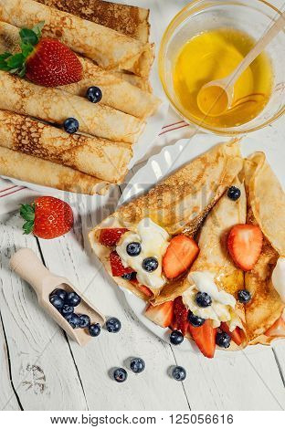 Homemade pancakes with wipped cream and fresh berries