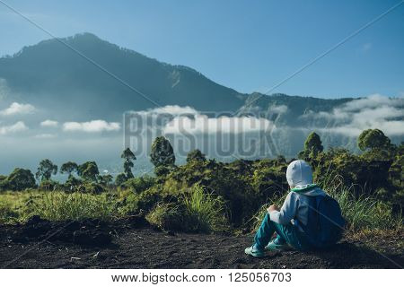 Boy Looking On Batur Volcano And Agung Mountain View At Morning From Kintamani, Bali, Indonesia
