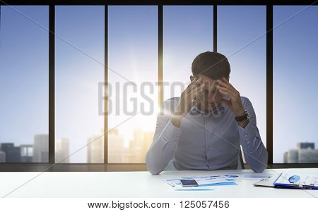 business, deadline, fail, people and stress concept - close up of anxious businessman with papers and smartphone