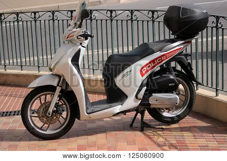 Monte-Carlo Monaco - April 6 2016: Honda SH 125i Motorbike Standing in Front of the Police Station. Motorcycles of Monaco Police Patrol on the City Street of Monte-Carlo