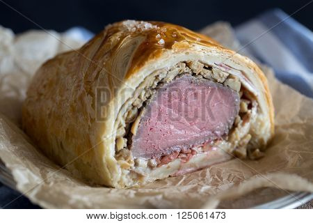 Beef Wellington on a food paper. selective focus