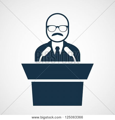 Bald-headed man at rostrum - speaker in glasses at tribune