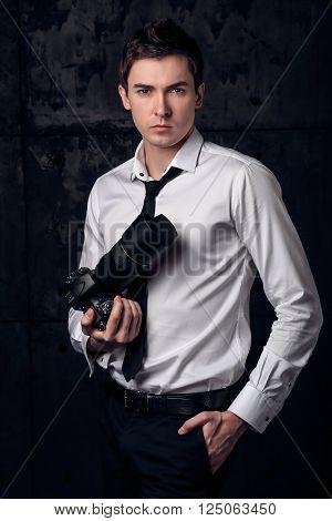 Portrait of Freelancer professional photographer in studio