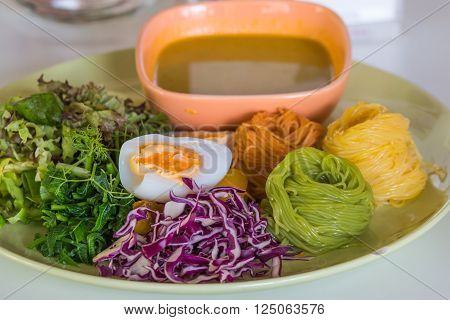 Thai rice vermicelli served with curry, serve with fresh vegetables, eggs, thai food