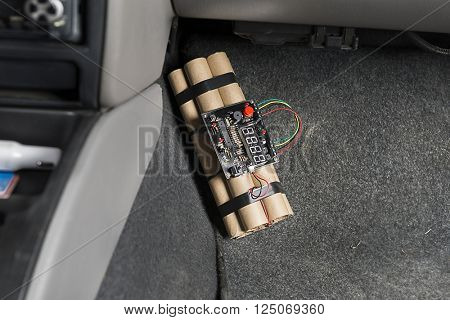 Time bomb placed in car.