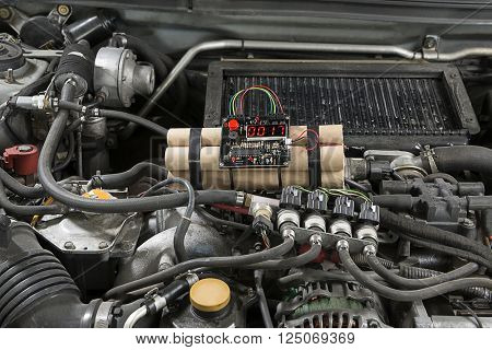 Time bomb placed inside car engine.