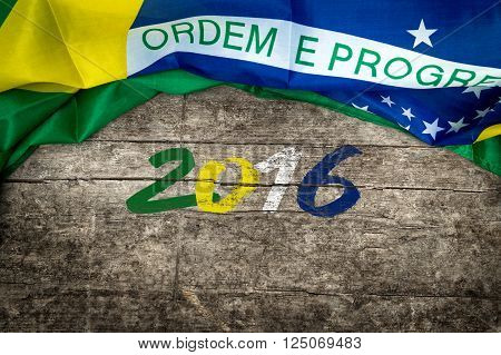 brazilian flag on s wooden background, with the numbers 2016