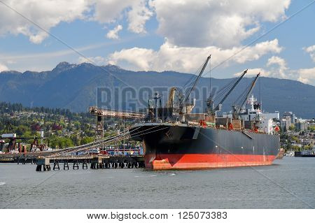 Large bulk carrier  in Vancouver Harbour. British Columbia, Canada.