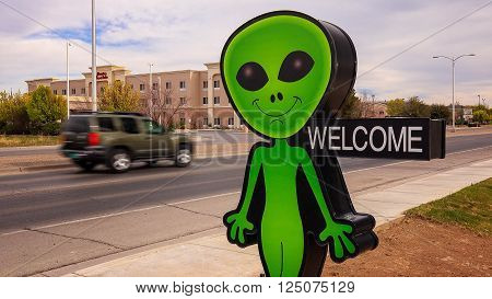 ROSWELL, NEW MEXICO - MARCH 28: A little green alien welcomes visitors in Roswell, New Mexico on March 28th, 2016.