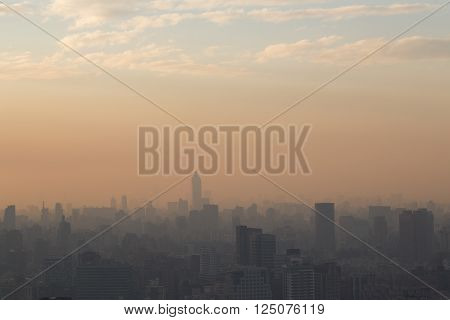 Taipei, Taiwan - January 05, 2015: Photograph of skyline submerged in smog during sunset.