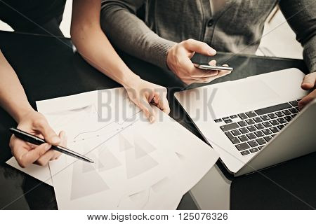 Business situation, team work. Closeup photo finance manager working modern office with new business project. Using laptop, smartphone, startup idea. Horizontal.
