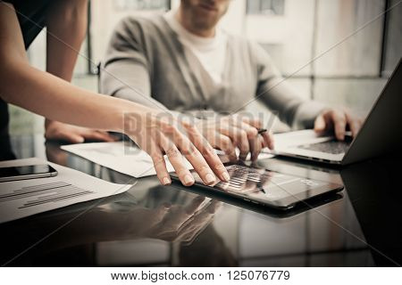 Finance department working process.Photo woman showing business reports modern tablet. Banker boss holding pen for signs documents, discussion startup idea.Horizontal.