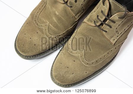 brown pair of used suede shoes on white background