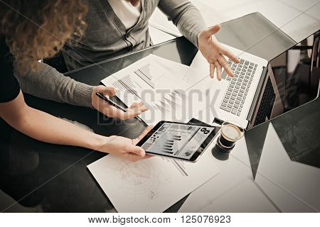 Research department working process.Photo woman showing business reports modern tablet. Statistics graphics screen.Banker holding pen for signs documents, discussion startup idea.
