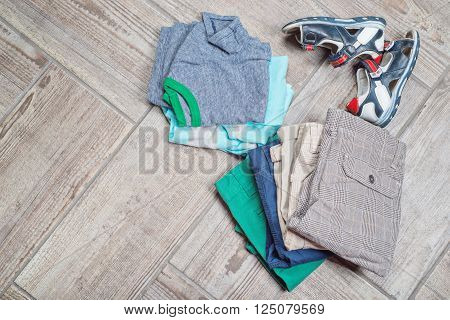 Photography of boy's casual outfits. Boy's casual outfits on wood board background