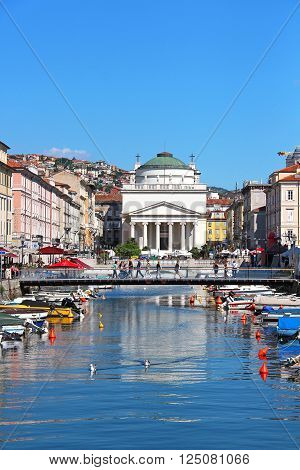 TRIESTE, ITALY - May 25, 2014: Grand canal and St. Antonio Taumaturgo church in downtown Trieste